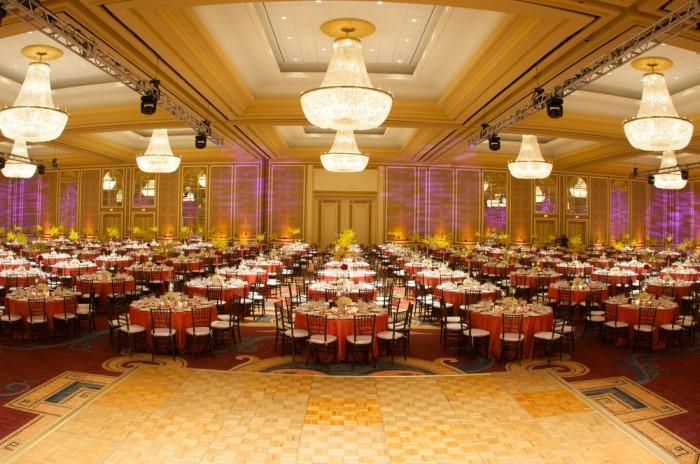 Blue Spark Event Design - Orange dazzle linen, brown chivari, centerpieces, large ballroom